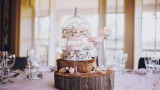 Beautiful rustic birdcage with wooden slices as wedding table centerpiece.jpg