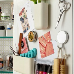 Diy bathroom organization ideas mount a magnetic memo board inside a cabinet door to add more storage with magnetic containers via bhg.jpg