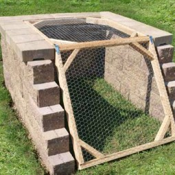 Angled compost bin to keep critters out.jpg