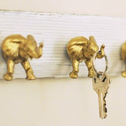 Use plastic toys gold spray paint and driftwood to make these cute key hooks.jpg