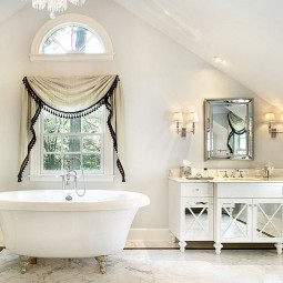 All white bathroom with a relaxed shabby chic style.jpg