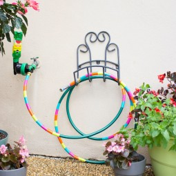 With just a little colored duct tape transform your ordinary garden hose into a work of art.jpg
