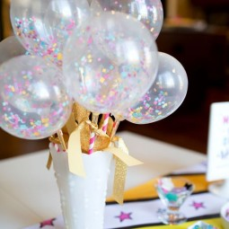 03 a white vase with glitter gold paper and sheer balloons with colorful confetti inside.jpg
