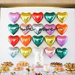 05 colorful heart balloons as a backdrop for the dessert table.jpg