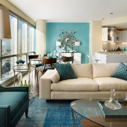Blue living room design with blue and cream accent.jpg