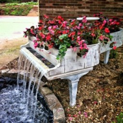 Old piano turned into outdoor fountain.jpg