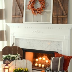 Diy wood pumpkins and barn wood shutter mantel.jpg