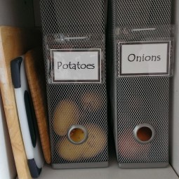 Use magazine holders to keep your onions and potatoes.jpg