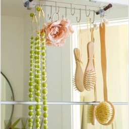 Hang a hook rod over the mirror for some extra storage space.jpg