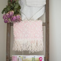 Dried roses and vintage linens on an old ladder.jpg