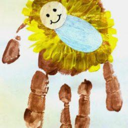 Baby jesus manger handprint craft.jpg
