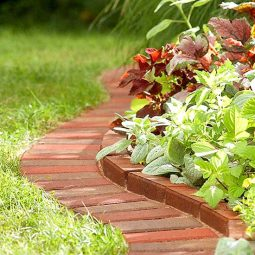 Brick flower bed lawn edging.jpg