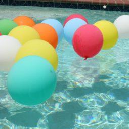 Pool party balloons in pool.jpg